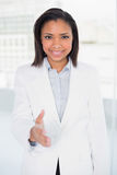 Pretty young dark haired businesswoman presenting herself Royalty Free Stock Images