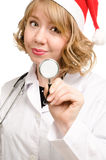 Pretty young doctor in a Santa Royalty Free Stock Photo