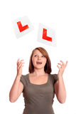 Pretty young driver passing her test Royalty Free Stock Images