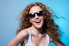 Pretty young emotional girl in sunglasses Stock Photography