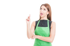 Pretty young employee having a great idea. And poiting finger up isolated on white background with advertising area Stock Images