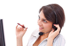 Pretty young executive in headphones Stock Image