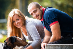 Pretty Young Family With Dogs Stock Photos