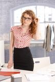 Pretty young fashion designer girl in office Royalty Free Stock Images