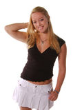 Pretty Young Fashion Model. Pretty Young Blonde Fashion Model in a white skirt and black top Stock Images