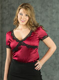 Pretty Young Fashion Model. A yooung fashion model posing in a red and black outfit royalty free stock photos