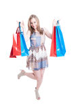 Pretty young fashion woman in full body holding shopping bags Royalty Free Stock Image