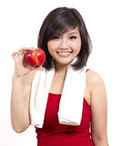 Pretty young female with apple and towel Stock Image