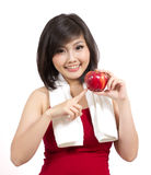 Pretty young female with apple and towel Royalty Free Stock Photo