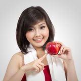 Pretty young female with apple and towel Royalty Free Stock Images