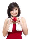 Pretty young female with apple and towel Stock Photos