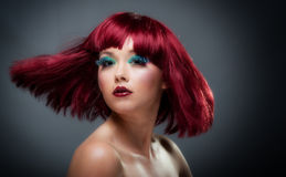 Pretty young female with auburn hair and makeup Stock Photo