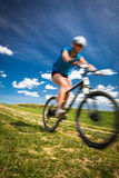 Pretty, young female biker outdoors on her mountain bike Royalty Free Stock Photography