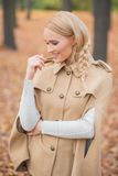 Pretty Young Female in Brown Autumn Fashion Royalty Free Stock Images