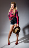 Pretty young female casual clothes and straw hat Royalty Free Stock Photos