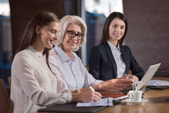 Pretty young female colleagues and their boss working in office Royalty Free Stock Photography
