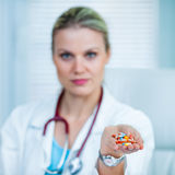 Pretty Young Female Doctor Is Showing a Handful of Medication Royalty Free Stock Images