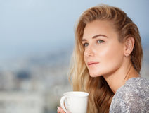 Pretty young female drinks tea royalty free stock images