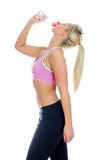 Pretty young female fitness trainer Royalty Free Stock Photo