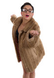 Pretty young female in fur coat Stock Photos