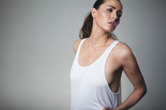 Pretty young female model posing tank top Royalty Free Stock Photography
