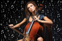 Pretty young female musician playing the cello Stock Image