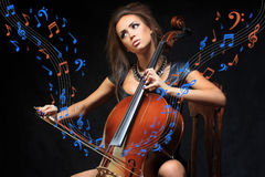 Pretty young female musician playing the cello Stock Images