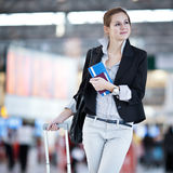 Pretty young female passenger at the airport Royalty Free Stock Image