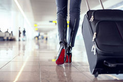 Pretty young female passenger at the airport. Young female passenger at the airport Stock Photos