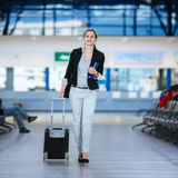 Pretty young female passenger at the airport Royalty Free Stock Photography