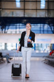 Pretty young female passenger at the airport Royalty Free Stock Photos