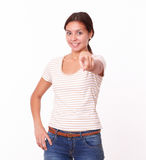 Pretty young female pointing at you Stock Photo