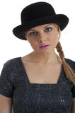Pretty young female in retro 60s style and bowler Royalty Free Stock Photos