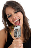 Pretty young female with retro microphone isolated Stock Photo