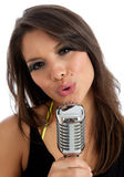 Pretty young female with retro microphone isolated Royalty Free Stock Image