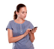 Pretty young female sending message by cellphone Stock Image