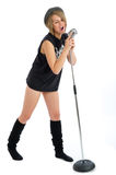 Pretty young female singer with retro microphone Royalty Free Stock Photos