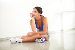 Pretty young female sitting in yoga class Royalty Free Stock Photos