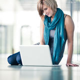 Pretty young female student  on college/university campus Royalty Free Stock Image