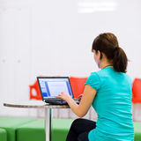 Pretty young female student with laptop Royalty Free Stock Photos