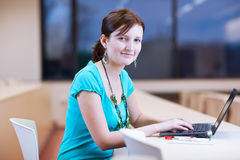 Pretty young female student with laptop Stock Photo