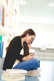 Pretty young female student sitting studying Royalty Free Stock Image
