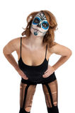 Pretty young female in sugar skull make up Stock Images