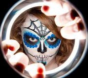 Pretty young female in sugar skull make up Stock Photo
