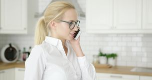 Pretty young female talking by phone stock video footage