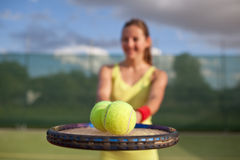 Pretty, young female tennis player on the tennis court Stock Photo