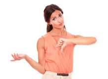 Pretty young female with thumb down Stock Image