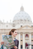 Pretty young female tourist studying a map Stock Images