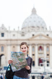 Pretty young female tourist studying a map Stock Photo