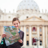 Pretty young female tourist studying a map Stock Photos